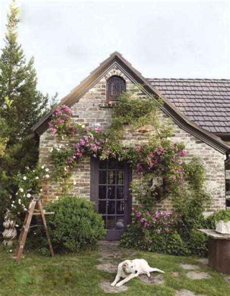 english country cottage home stone english cottage garden brick home with flowering vines growing along its walls