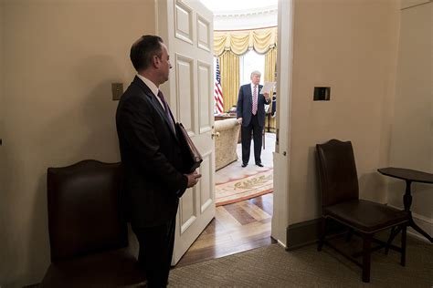 donald trump office file chief of staff reince priebus looks into the oval office as president donald trump reads