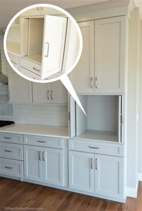 tv for kitchen cabinet pocket doors in kitchen cabinetry perfect for hiding a tv