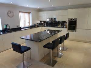 Magnet Kitchens by Central Island With Cosmic Black Granite Worktop