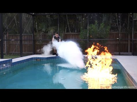 the backyard scientist puts out a flaming swimming pool