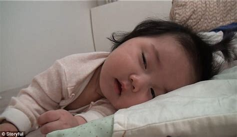 sleeping in asia baby in south korea battles to stay awake to smile at mum