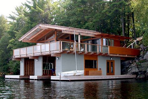 lake land house boat altius architecture inc action island boathouse