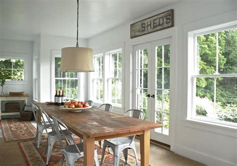 farmhouse dining room framing the table a perfect pendant for family gatherings