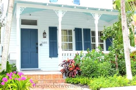 Best Affordable Front Doors - white house blue shutters affordable key west house front