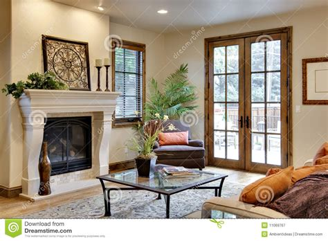 Home Floor Plans Prices great room with fireplace and french doors royalty free