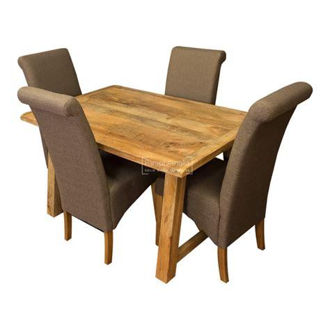 mango wood upholstered dining chairs garda light mango wood 135cm dining table four fabric chairs
