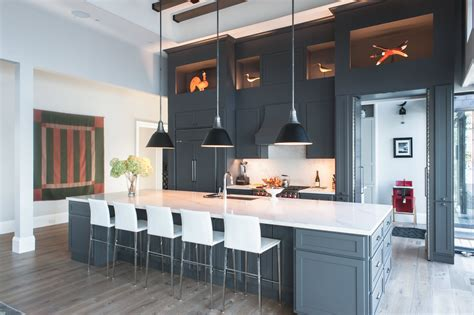 stunning cottage kitchen  dark cabinets white quartz