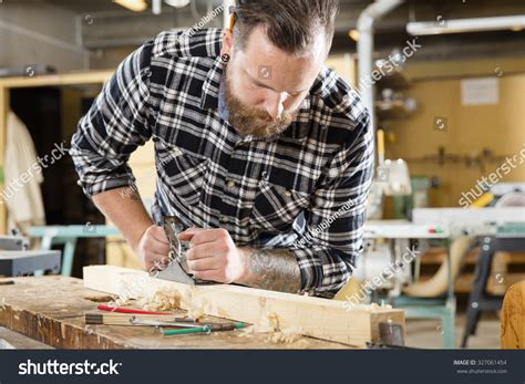 working man tattoo working craftsman working planer workshop stock photo
