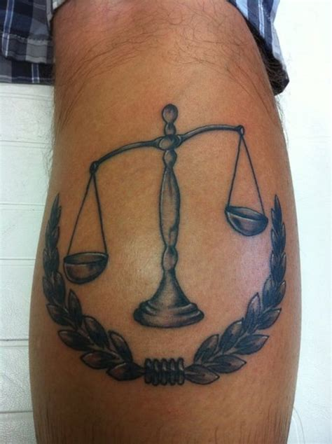 scales of justice tattoo justice scales on back of leg bite