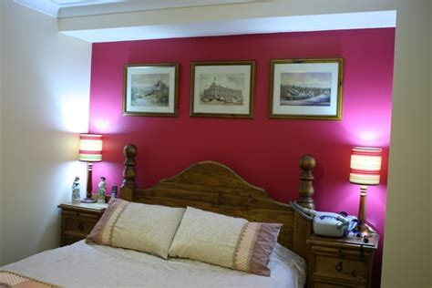 pink accent wall with white paint color for small bedroom ideas using two colors combination