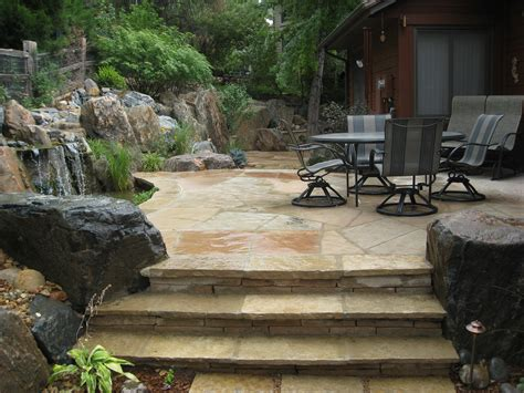 flagstone patio and stairs with boulders