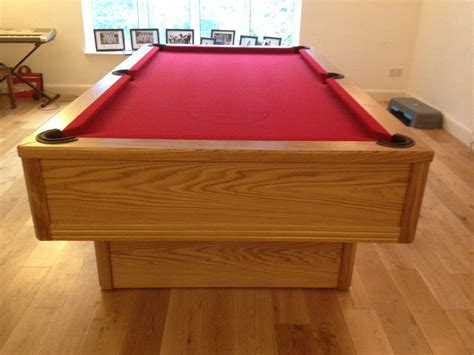emperor in oak with red cloth modern bespoke uk pool tables