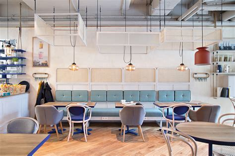 Mid Century Modern Design Ideas contemporary lamps bright up this scandinavian coffee shop