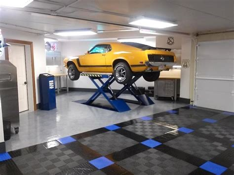 Automobile Lifts For Home Garage racedeck floored home garage with infloor car lift flooring by racedeck