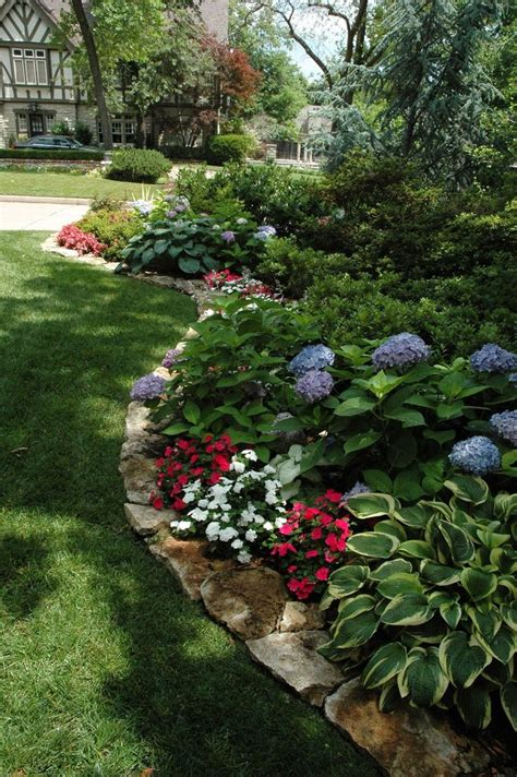 flower beds in front of house rustic flower beds with rocks in front of house ideas 13