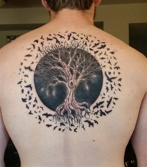 tree of life with a solar eclipse surrounded by birds