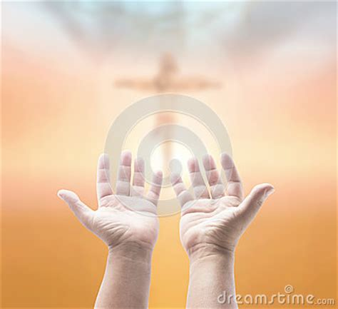 praying over blurred the cross stock photo image: 47635295