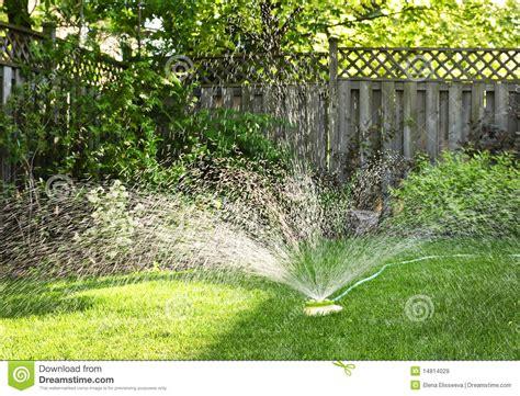 backyard sprinkler lawn sprinkler watering grass royalty free stock images