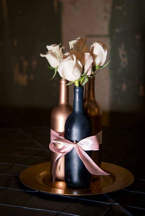 Designed by Bethany's Bouquets. Wine bottle centerpiece
