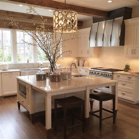 kitchen island as dining table with backless brown leather nailhead stools transitional kitchen