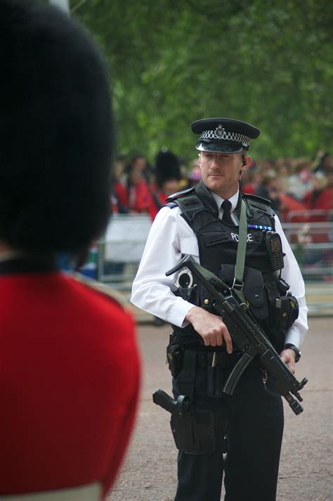 Two Officers by Authorised Firearms Officer