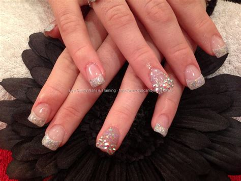 Acrylic Tipis eye nails acrylic nails with swarovski crystals on tips on ring fingers and