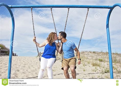 couple swing couple kissing on swings stock image image of romance