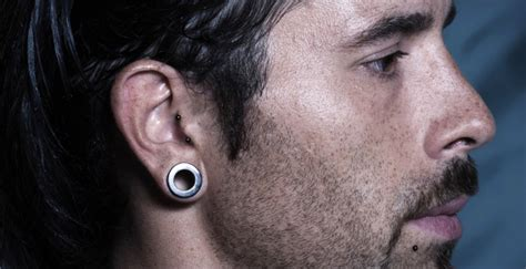 male stars with ears pierced rising stars of modern piercing the vertical tragus