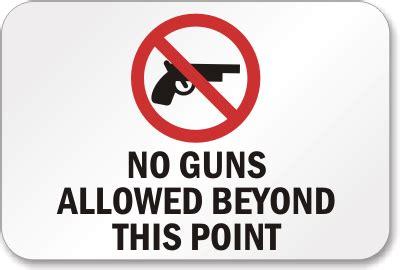 no guns allowed beyond point sign