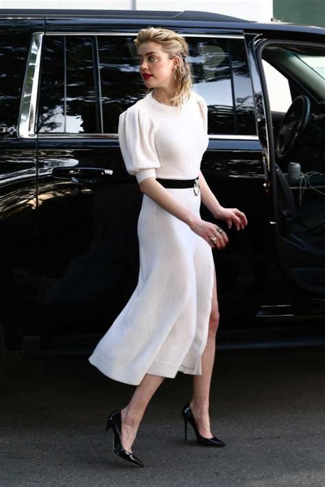 amber heard   white dress leaves univision headquarters