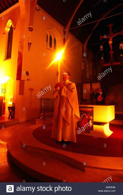 vigil lights catholic church lighting the paschal candle at easter vigil at st josephs