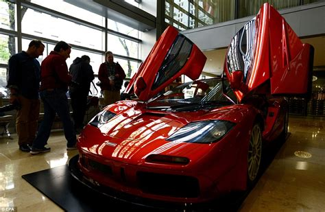 car doors that swing up rare red mclaren f1 sports car expected to fetch over