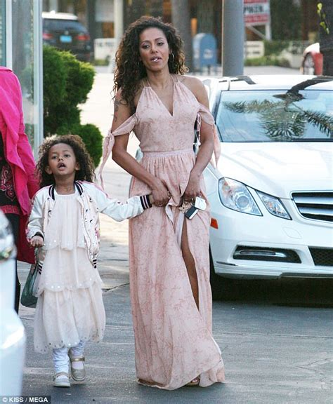 Mel Dres Pink mel b shows toned legs in a revealing boho dress
