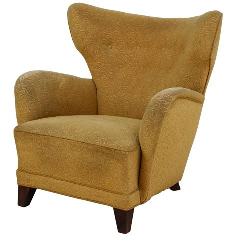 Wingback Chair Upholstery by Wingback Lounge Chair With Yellow Upholstery 1940s