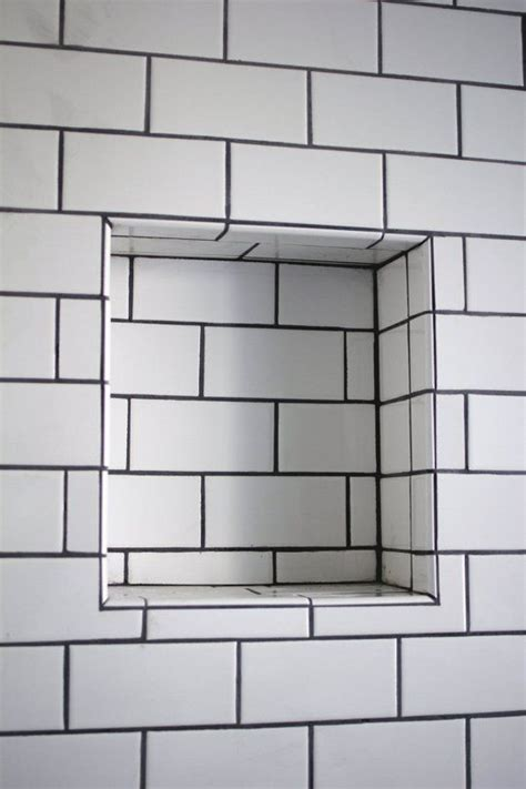 white tile black grout bathroom recessed