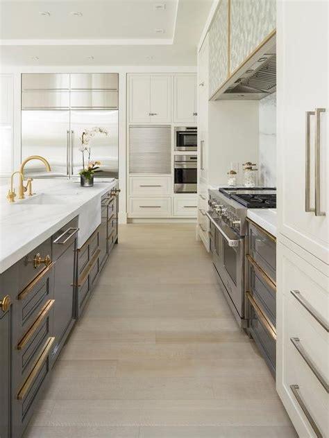 calcutta marble waterfall kitchen island  blond wood