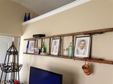 hanging l into wall repurposed wooden ladder used quot l quot brackets to hang