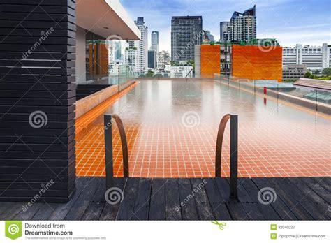 orange swimming pool  rooftop  modern buildi royalty