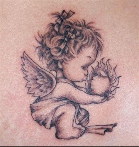 tattoo angel holding baby i want this little angel tattoo on my foot but she will be