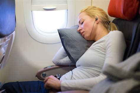 most comfortable way to sleep on a plane woman s headphones explode midflight after she falls