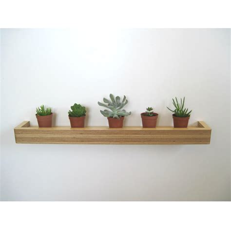 what to put on a shelf in the living room slimline floating shelf homeware furniture and gifts mocha