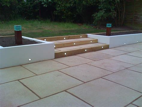 contemporary patio paving lighting in rendered wall outdoors
