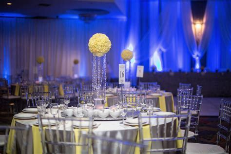 Yellow and grey reception decor with blue uplighting