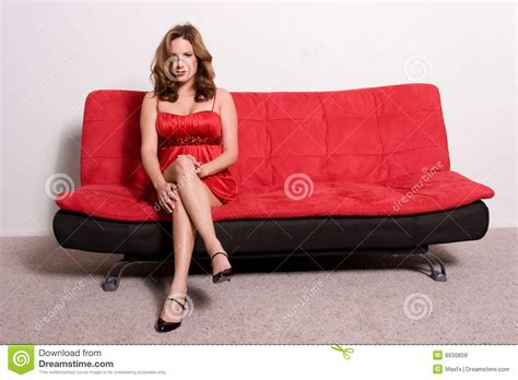 sitting on a sofa woman sitting on sofa royalty free stock images image