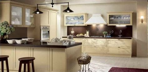 kitchen reno cream cabinets with brown counters and