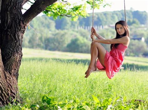 the girl in the swing girl sitting on a swing wallpapers and images wallpapers