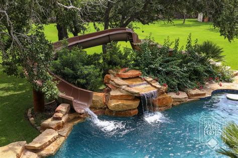 This Swimming Pool With Slide And Waterfall Would Look Amazing Backyard Pools