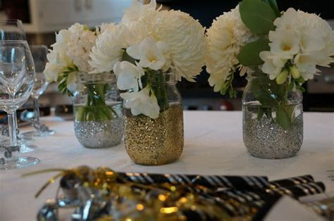black and gold mason jar centerpeices   mason jars glitter