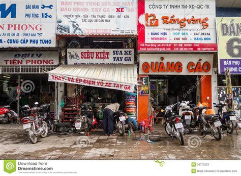 neon light repair shop colourful motorbike repair shops editorial stock photo